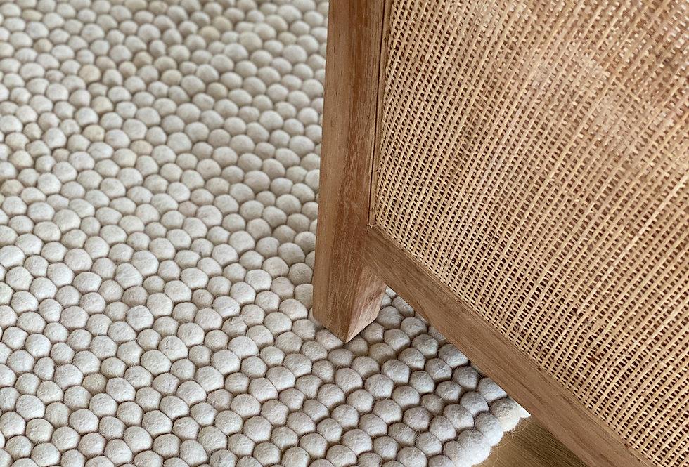 White wool rug in living room.