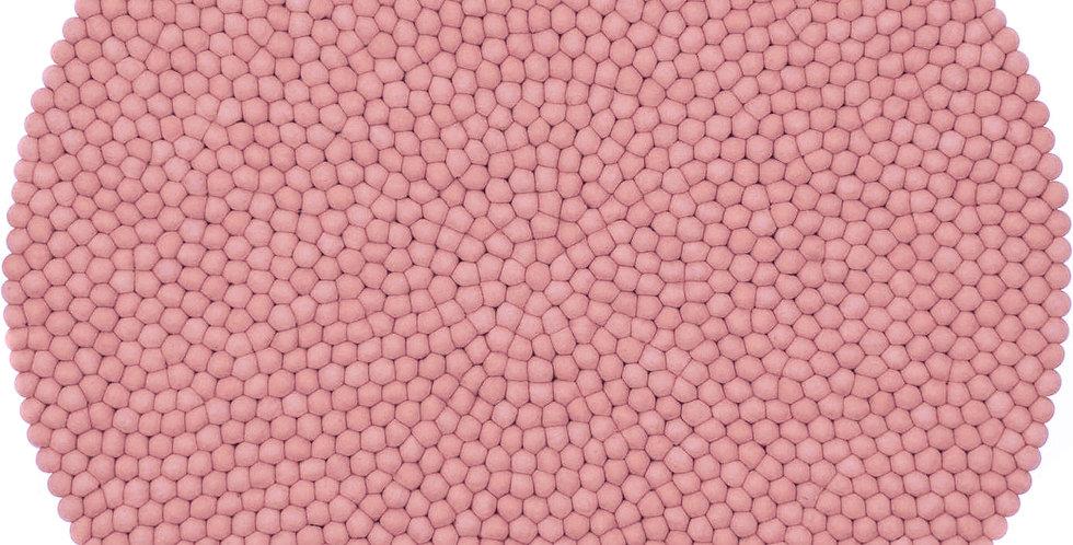 Pink round rug full view.
