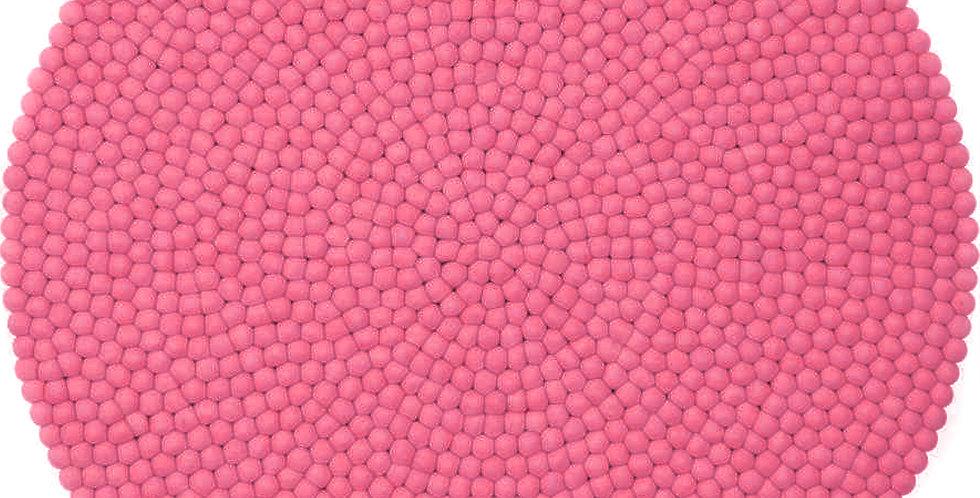 Bright pink round rug full view.