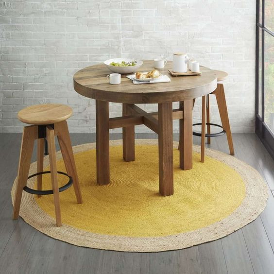Round rug styling with cool furniture.