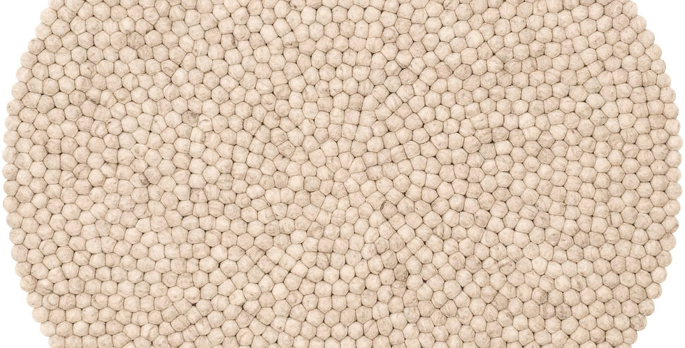 Cream round rug full view.