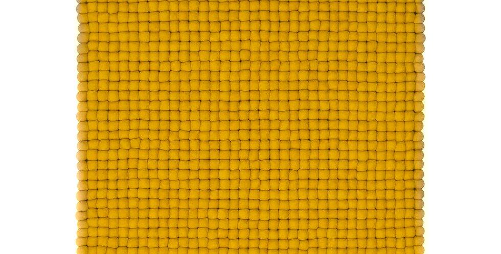 Mustard yellow rug full view.