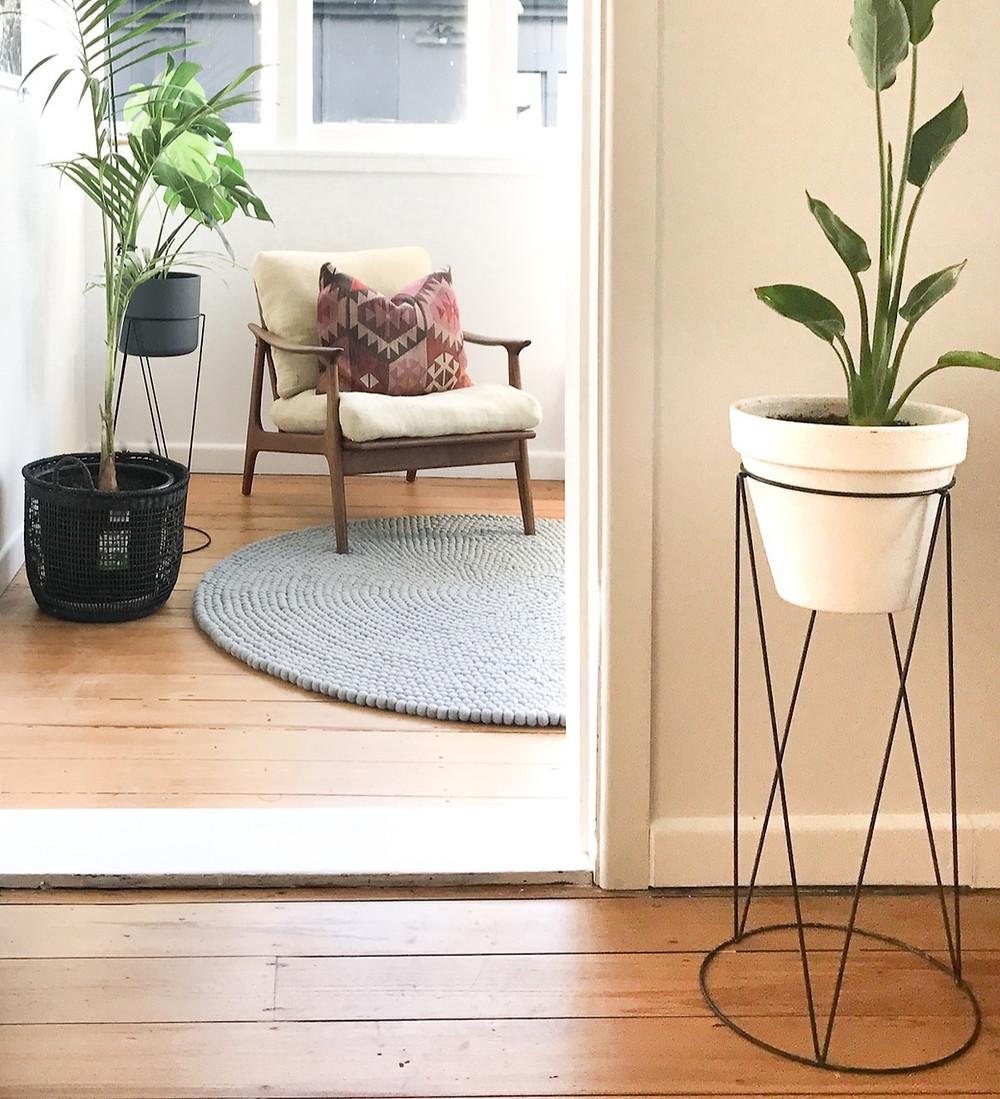 Grey rug in entryway of home.