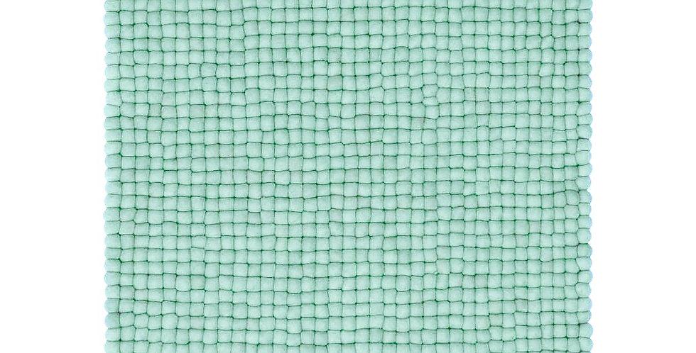 Light blue textured felt ball rug full view