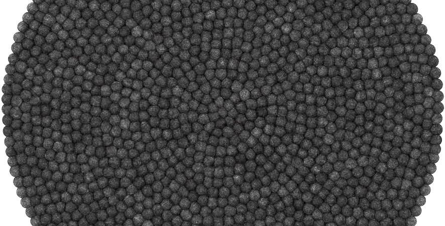 Black felt ball rug full view