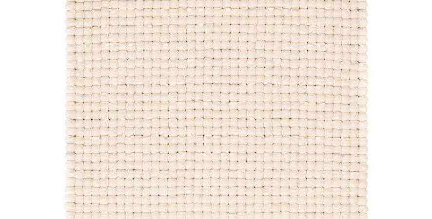 White felt ball rug full view.