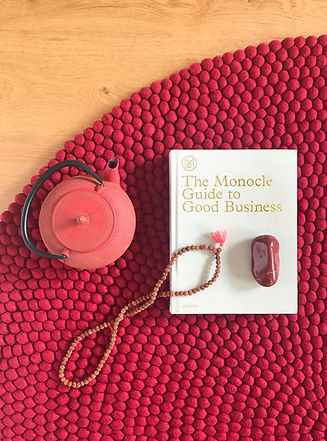Rug textured rug with teapot and book ontop of it.