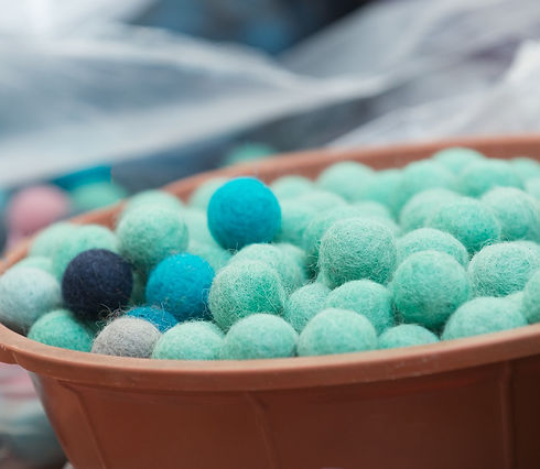 Blue felt balls for making wool rug.