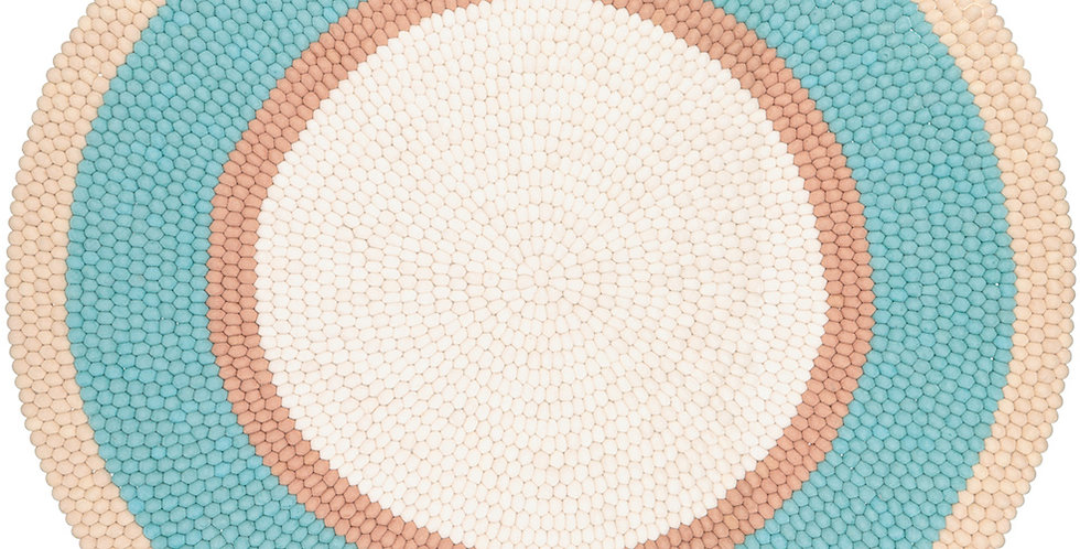 Blue, tan and white round rug full view.