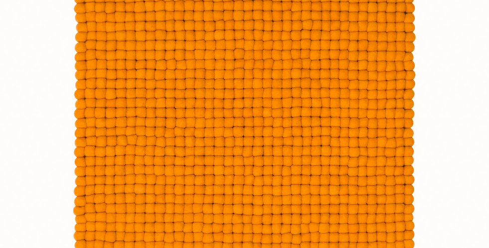 Bright orange felt ball rug