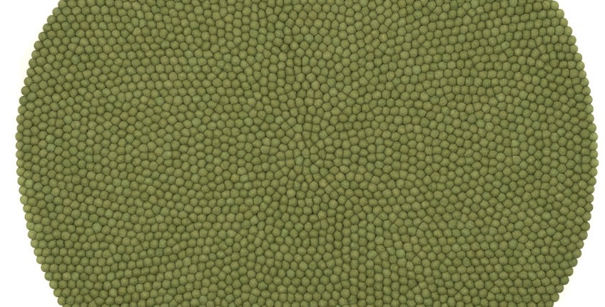 Green round textured rug full view.