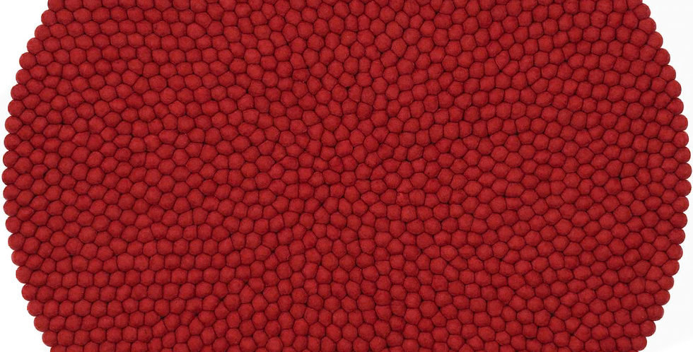 Red round rug full view.