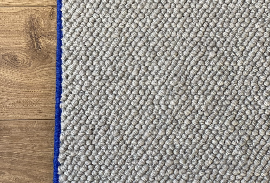 Wool hallway runner w. blue trim.