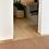 Brown felt ball rug in home decor.