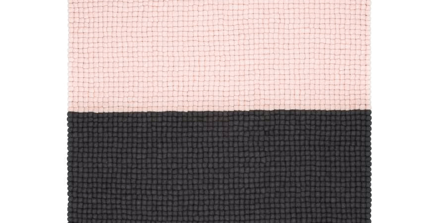 Pink and black wool rug full view.