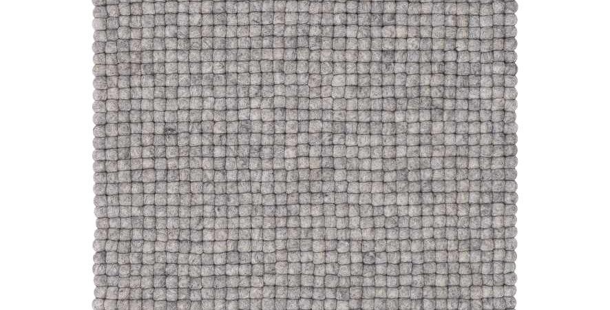 Grey rug natural sheep wool full view.