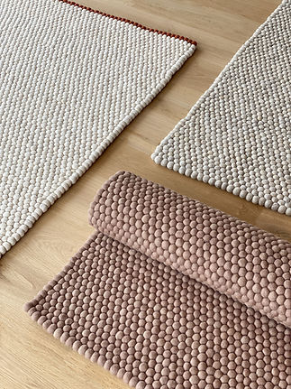 Brown and white textured rugs in livingroom