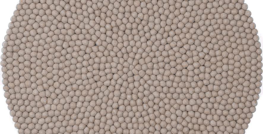 Mushroom coloured round rug full view.