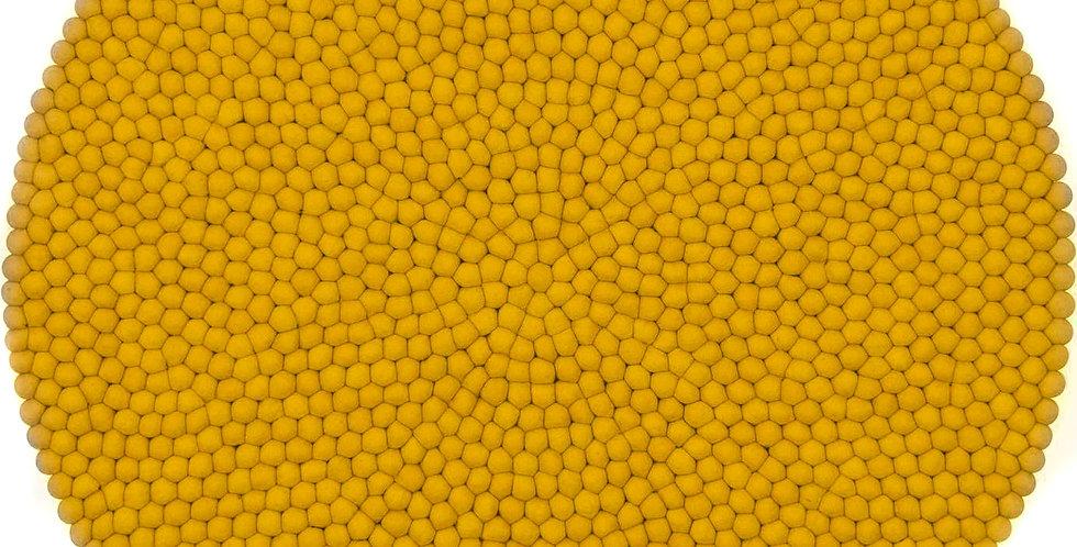Mustard yellow round rug full view.
