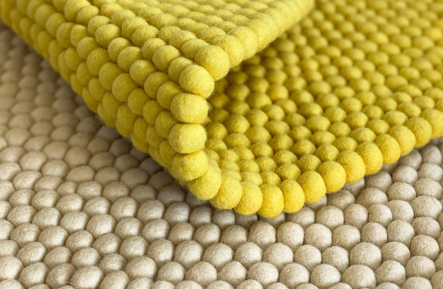 Yellow textured rug.