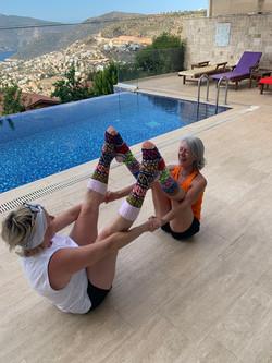 Yoga With VickiB yoga teacher and student having fun poolside in Kalkan, Turkey