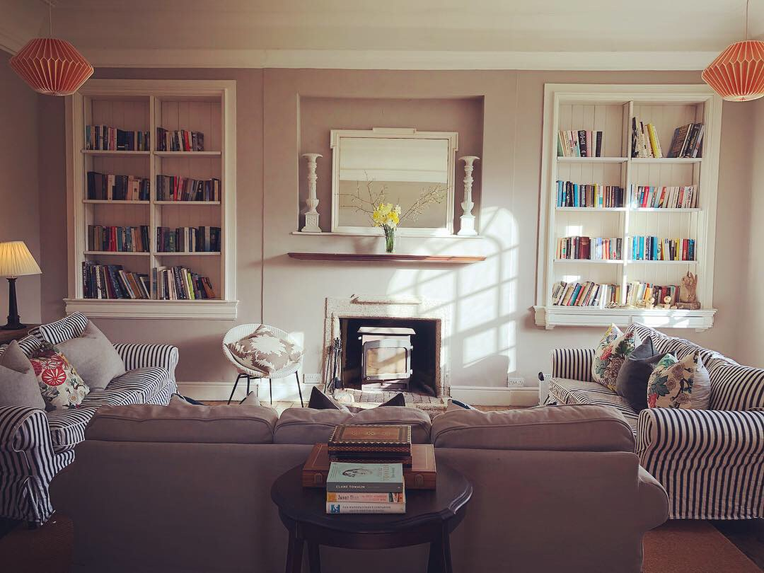 The calming Library at Tilton House in the rolling landscape of Sussex Downs, location for the YogaW