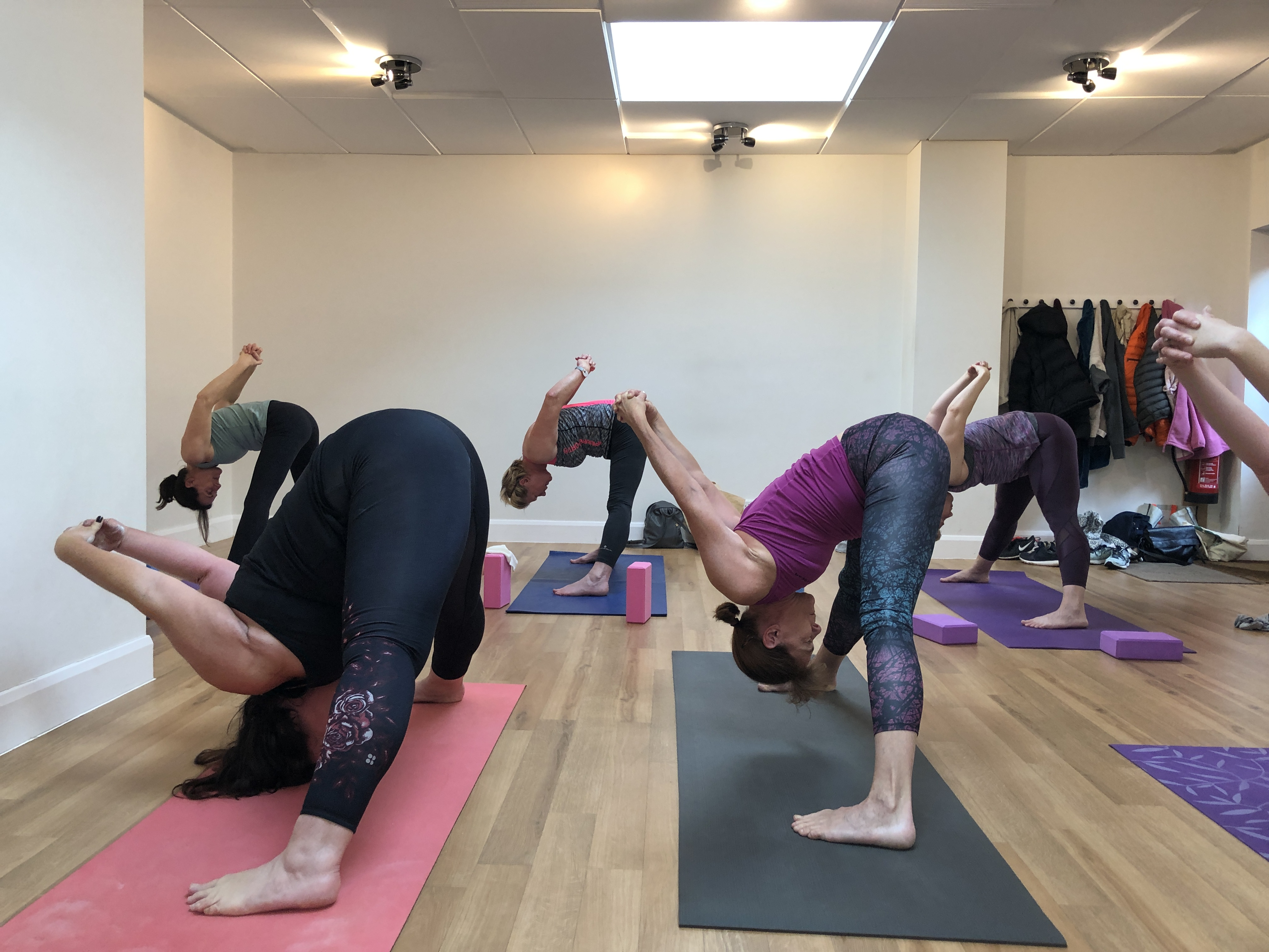 YogaWithVickiB class, wide legged forward fold yoga pose
