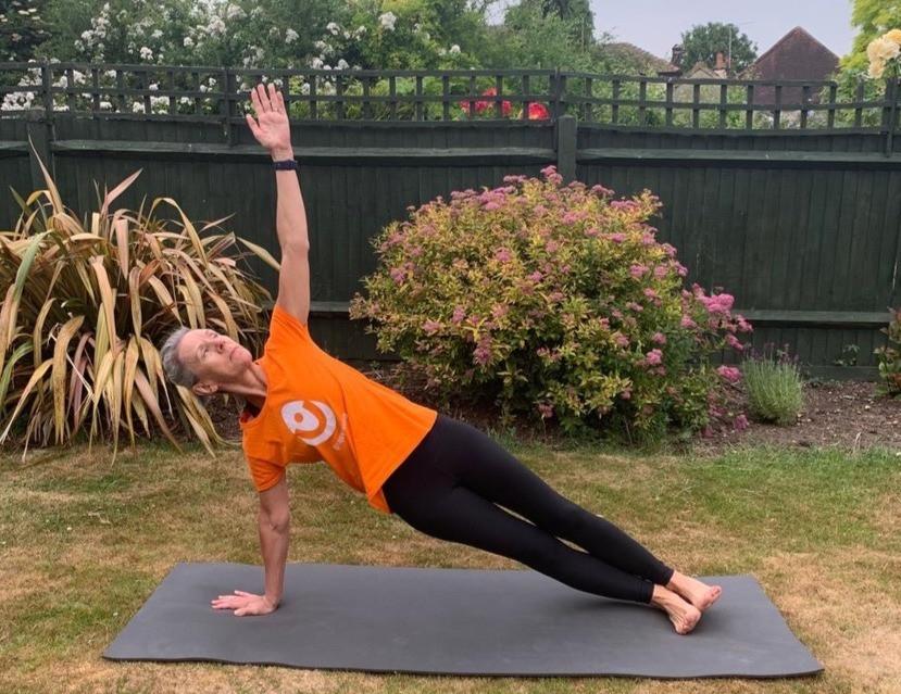 Yoga teacher Vicki Baumann of Yogawithvickib demonstrating yoga pose Side Plank.