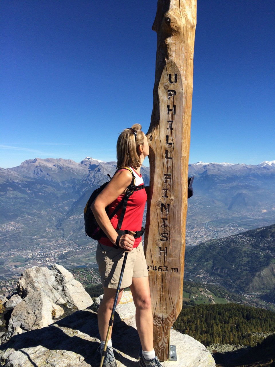 Yoga Teacher Yogawithvickib hiking to top of Swiss Mountain