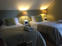 One of the bedrooms at Tilton House in the Sussex Downs, location for the YogaWithVickiB ladies-only