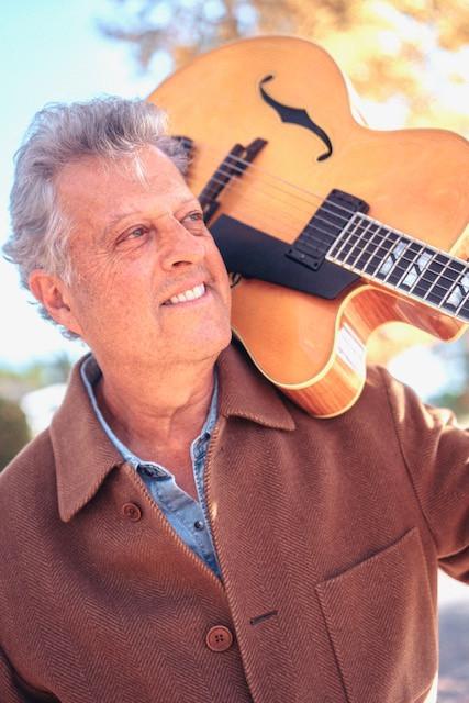 Grammy award winning guitarist & producer, Paul Brown, in the coat he got at Armani Wells, 2020