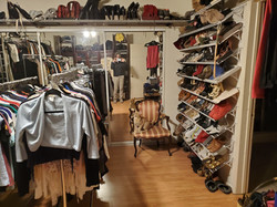 After closet room with shoes now displayed on shelving in lieu of mounded on the floor