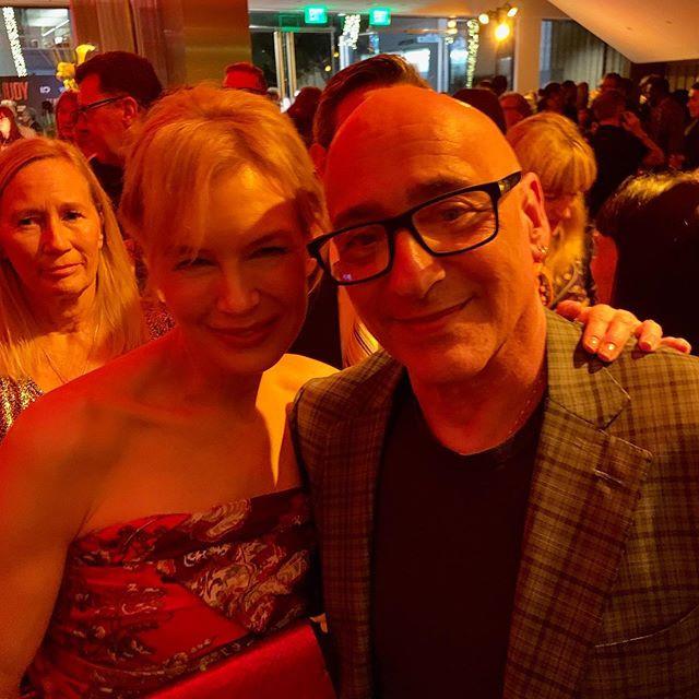 Allan Rich wearing Isaia with Renee Zellweger