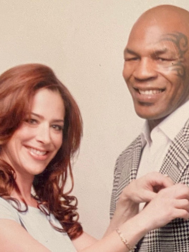 Claudia Wells dressing Mike Tyson