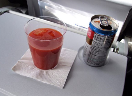 Why is tomato juice so popular on a long-haul flights?