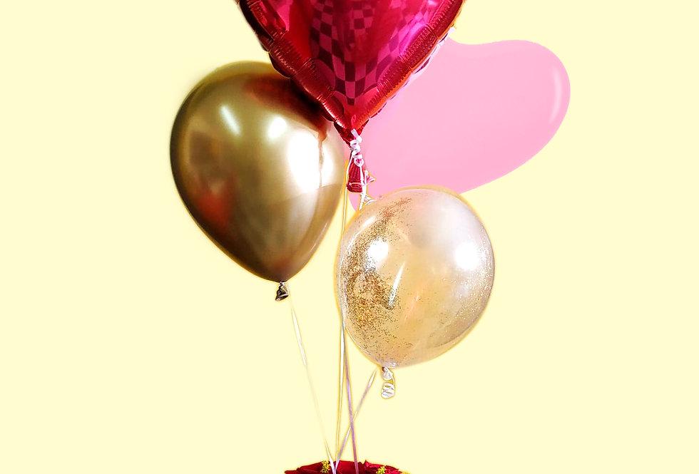 centro de mesas con rosas y globos