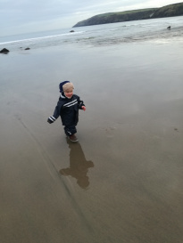1 year old running wild on the beach