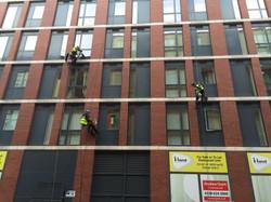 An Insightuk Abseil Team cleaning Appartment windows