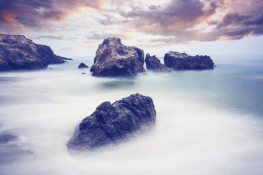 Misty sea scape with rocks