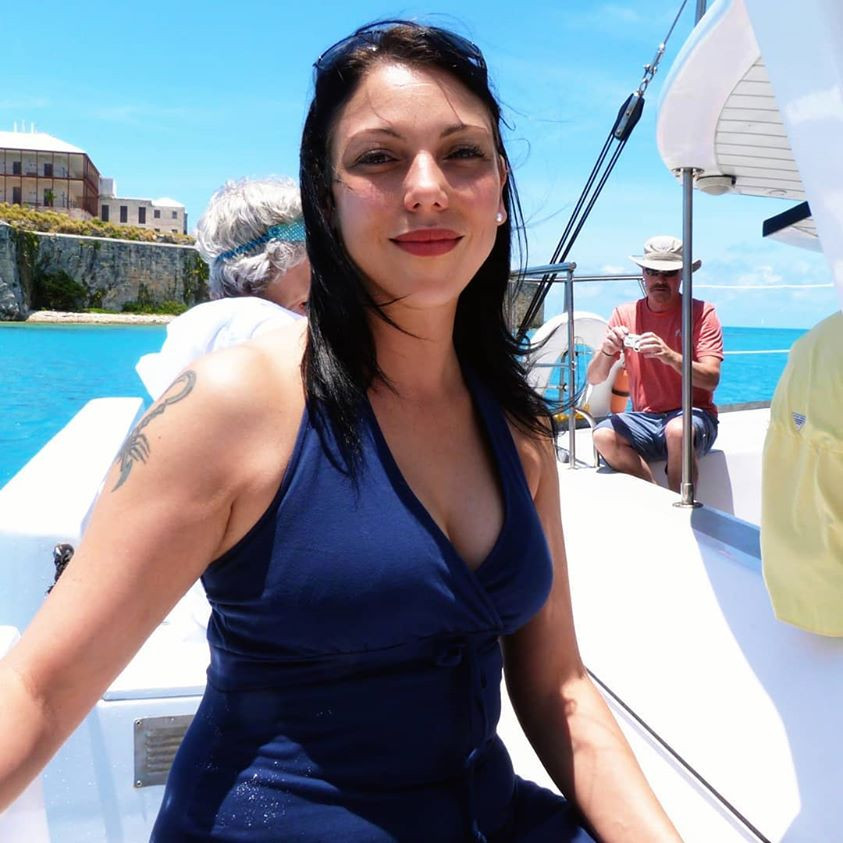 out on a boat, bermuda, blue sky, blue water, turquoise water, blue dress, woman, shades, brown hair, makeup, great weather, sunny