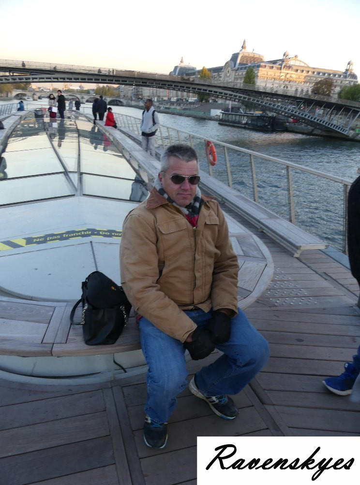Cold man on boat tour in Paris, France. Tour canals. Famous monuments, statues and buildings. Amazing views. Sunset cruise. Best place to get photographs. Ravenskyes