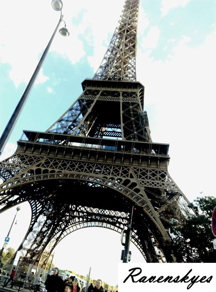Eiffel Tower in Paris. Large iron monument. Tourist attraction. Ravenskyes