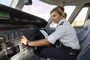 Italy, female pilot in an airplane's coc