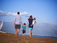Postnatal family enjoying the beach