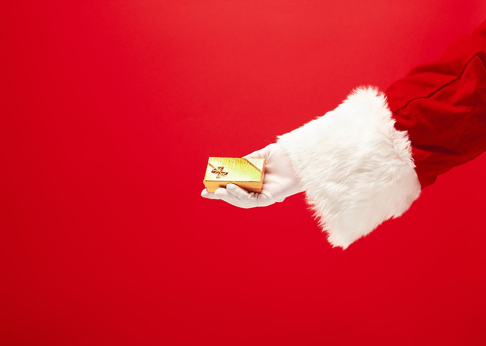 hand-santa-claus-holding-gift-red-backgr