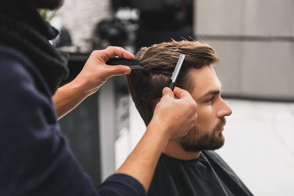 Male client getting haircut by hairdress