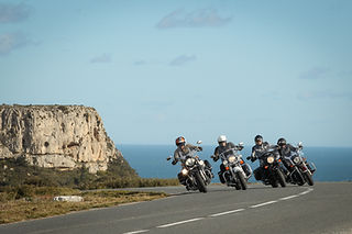 Motorcyclists riding through scenic roads in France
