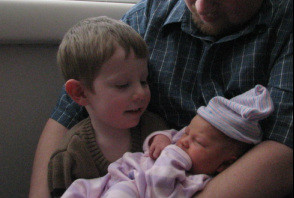 My son meeting his baby sister in Feb. 2007