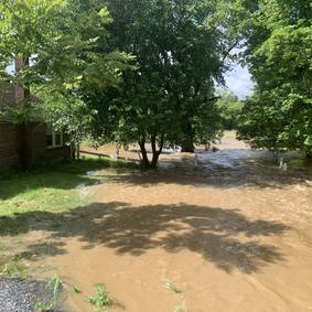 Flooding onto 2105 Creek Rd. House