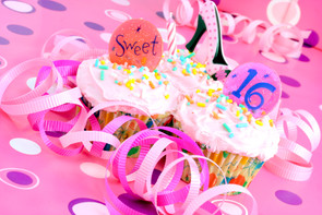 Two pink cupcakes with Sweet 16 on them
